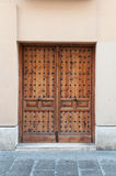 Old wooden door in a brick wall Stock Photography