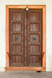 Old wooden door on a building facade. India, Agra Stock Photos