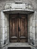 Old wooden door on building in old town of riga, Latvia Stock Images
