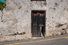Old wooden door on building ruin facade , abandoned house ,. Old wooden door on building ruin facade , abandoned house stock images