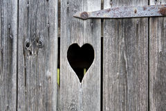 Old wooden door with a carved heart Royalty Free Stock Photo