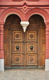 Old wooden door with carved ornament Royalty Free Stock Photos