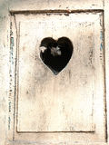 Old wooden door with a carved romantic heart Stock Photography