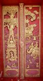 Old wooden door carved Thailand gold. Royalty Free Stock Photos