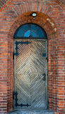 Old wooden door. In the centre of brick wall Stock Images