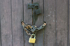 Old wooden door with Chain key Royalty Free Stock Photo