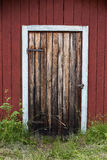 Old wooden door. Charming old wooden door in Dalarna, Sweden. Entrance to boat house stock photos