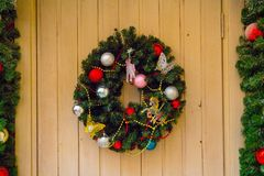 Old, wooden door with Christmas wreath. Old, wooden door with Christmas wreath, decoration stock photos
