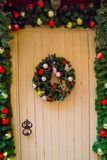 Old, wooden door with Christmas wreath. Old, wooden door with Christmas wreath, decoration stock photography