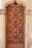 Old wooden door. In a church Royalty Free Stock Photos