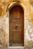 Old wooden door in city of Rethymno Stock Photo