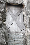 Old wooden door is closed it. Royalty Free Stock Image