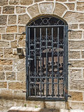 Old wooden door closed by a metal lattice Stock Photography