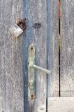 Old wooden door with a closed padlock Royalty Free Stock Photos