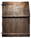 Old wooden door with compacted boards. insulated Royalty Free Stock Images