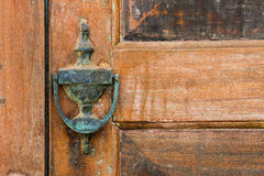 Old wooden door with copper knocker Stock Images