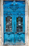 Old wooden door covered with cracks, worn paint. An ideal base f Royalty Free Stock Images