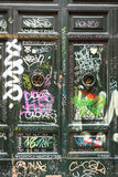 Old wooden door covered with graffiti  in Trastevere district. Rome, Royalty Free Stock Images