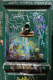 Old wooden door covered with graffiti  in Trastevere district. Rome Stock Image