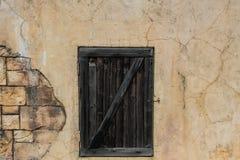 Old wooden door. Old wooden door on crack wall Royalty Free Stock Photography