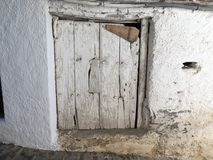 Old wooden door with cracks. In the village of Capileira Granada Spain Royalty Free Stock Photography