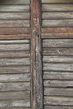 Old wooden door. With cross on it Stock Images