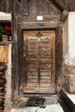 Old wooden door in D`ultimo. View of a weathered house with old door in a small village in the D`ultimo Stock Photos