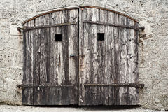 Old wooden door with damaged wall Royalty Free Stock Photography