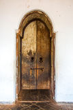 Old wooden door in Dambulla buddhist cave temple complex in Sri royalty free stock photo