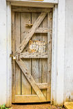 Old wooden door with danger sign Royalty Free Stock Image