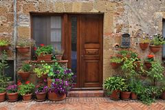 Old wooden door decorated with flower pots from the medieval tow royalty free stock photography