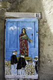 Old wooden door decorated with a painting with Jesus Royalty Free Stock Photo