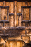 Old wooden door detail in brown Royalty Free Stock Photo