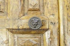 Old wooden door. Detail of a door knocker Royalty Free Stock Image