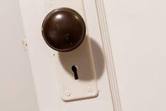 Old wooden door with door knob Stock Photos