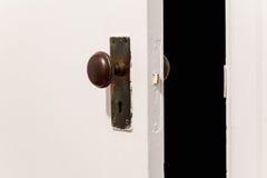 Old wooden door with door knob Royalty Free Stock Photography