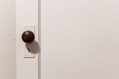Old wooden door with door knob Stock Image