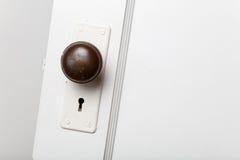 Old wooden door with door knob Stock Images