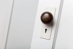 Old wooden door with door knob Royalty Free Stock Image