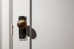 Old wooden door with door knob Royalty Free Stock Photos