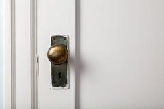 Old wooden door with door knob Royalty Free Stock Photo
