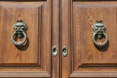 Old wooden door with doorknockers closeup Stock Image
