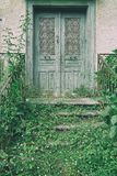 Old wooden door entrace. With vintage filter effect royalty free stock photo
