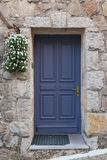 Old wooden door in the entrance stone house Stock Image