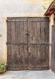 Old wooden door in the entrance stone house Royalty Free Stock Image