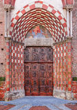 Old wooden door at the entrance to catholic church. Stock Photos