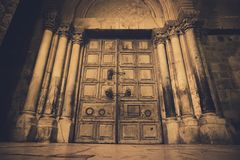Old wooden door of entrance to the Church of the Holy Sepulchre, also called the Church of the Resurrection or Church of the royalty free stock photos