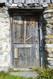 Old wooden door in farm house Stock Image