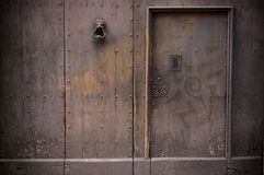Wooden door with doorknob Royalty Free Stock Photo