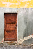 Old wooden door frame. With lock granary   on the old cracked wall Stock Photo